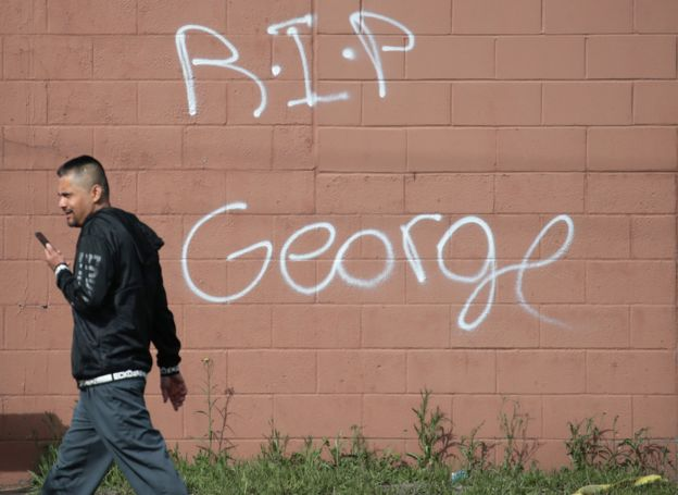 A wall is spray-painted RIP George
