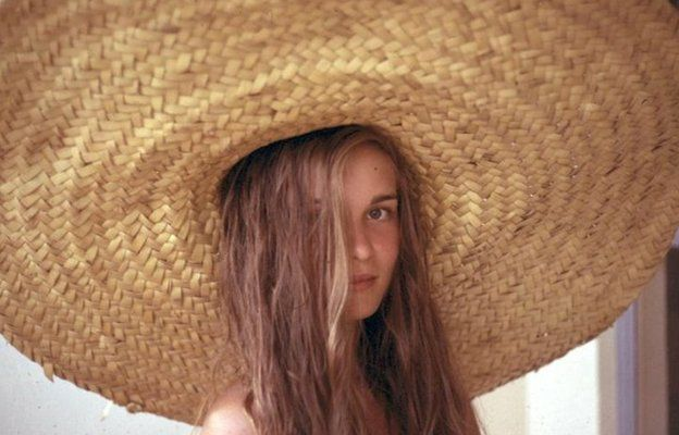 The young Marie-Claude Magne wearing a hat