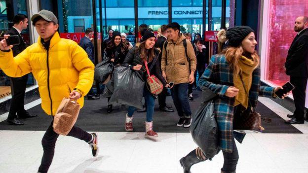 ea46b9d50971 Shoppers running into Selfridges in London as the doors open