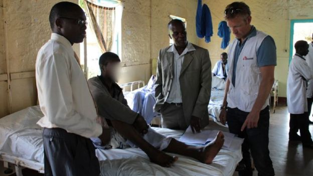 Dr Knut Eric Hovda with a methanol poisoning patient in Kenya