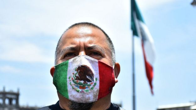 Man wearing Mexican flag mask