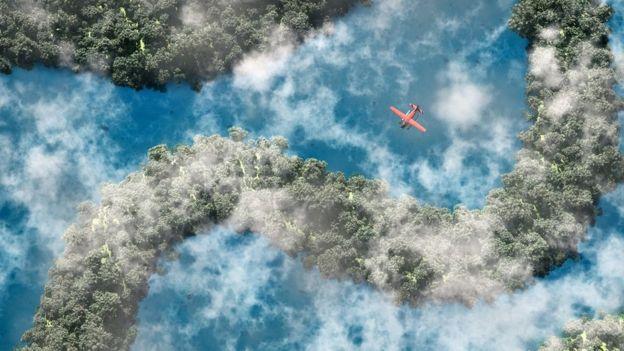 Foto aérea de avião sobrevoando a Floresta Amazônica