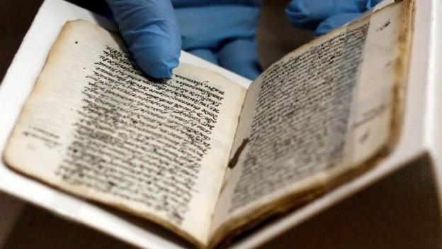An employee holds the 16th-century manuscript by Spanish-born Jew Luis de Carvajal the Younger as it is displayed to the media at the Anthropology museum in Mexico City, Mexico March 23, 2017.