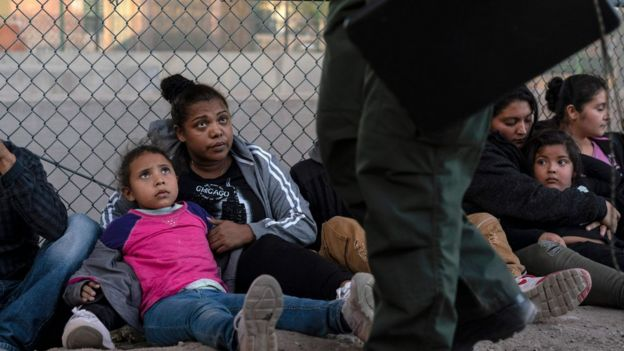 Migrants caught at the US border staring at CBP officers