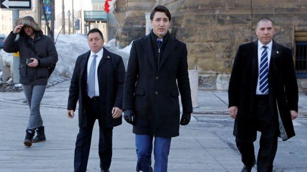 Canada's Prime Minister Justin Trudeau (centre)