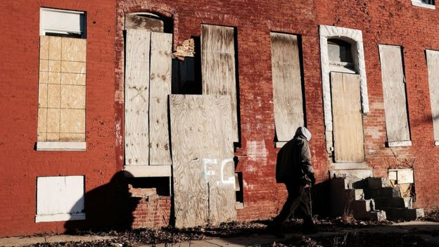 Abandoned buildings stand in a neighbourhood with a high murder rate on February 3, 2018 in Baltimore, Maryland.