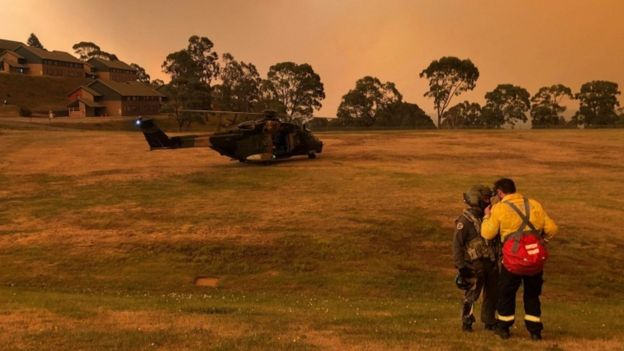 A helicopter on the field of a residential area in Victoria