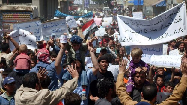Syrian anti-government protesters near the southern town of Deraa, in April, 2011