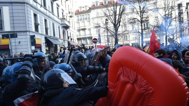 Protesters from anti-fascist groups clash with police during a rally in Milan, Italy, 24 February 2018