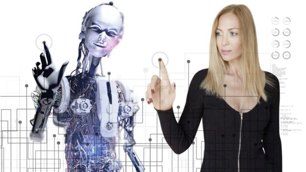 Woman and robot working together on touch screen