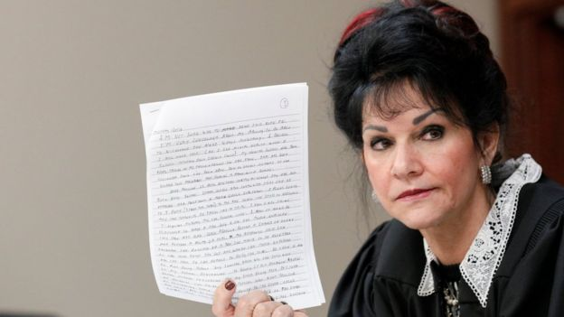 Judge Rosemarie Aquilina holds the letter written by former physician Larry Nassar