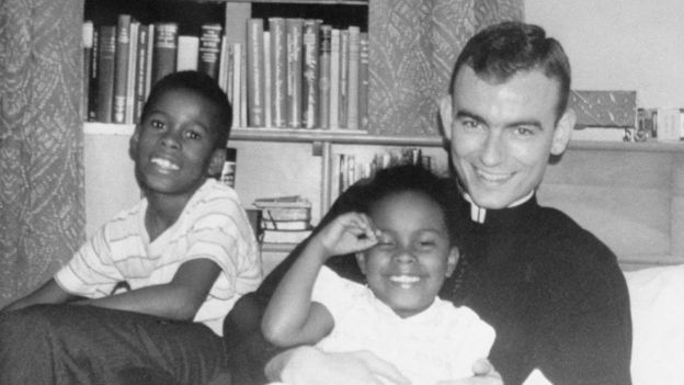 Jonathan Daniels with two African American children visiting him at his seminary