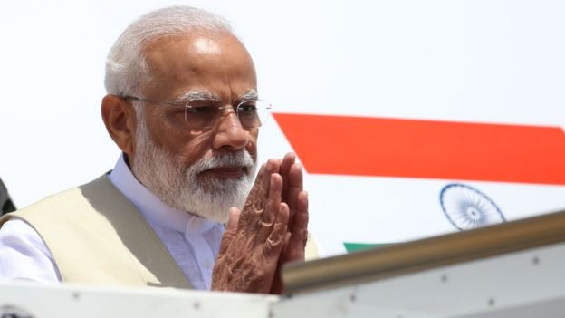 Prime Minister Narendra Modi acknowledges the reception as he arrives at in Sri Lanka on 9 June 2019.
