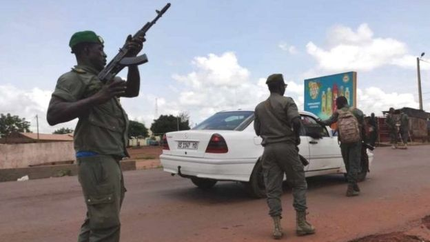Soldiers patrol after gunshots were heard Tuesday at a military camp near Kati area in Bamako, Mali on 18 August 2020
