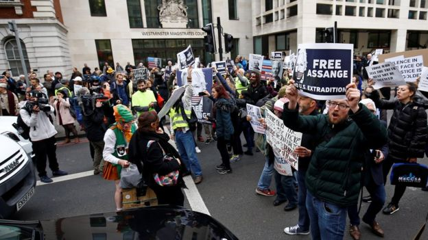 Demonstrators block traffic outside Westminster Magistrates' Court
