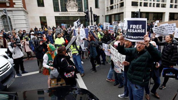 Demonstrators block traffic outside Westminster Magistrates' Court