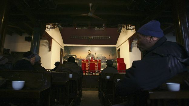 Audience watch and listen to Pingshu performance at a teahouse on February 8, 2006 in Shanghai, China