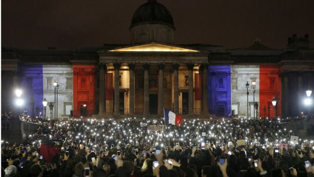 People take part in a vigil to pay tribute to the victims of the Paris attacks at Trafalgar Square in London
