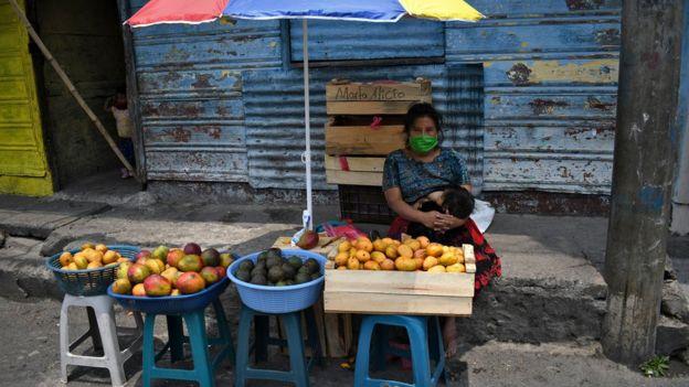 a woman selling fruit in Guatemala
