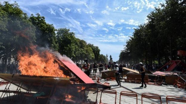 Demonstrators set ablaze a barricade at the rally in Nantes, France