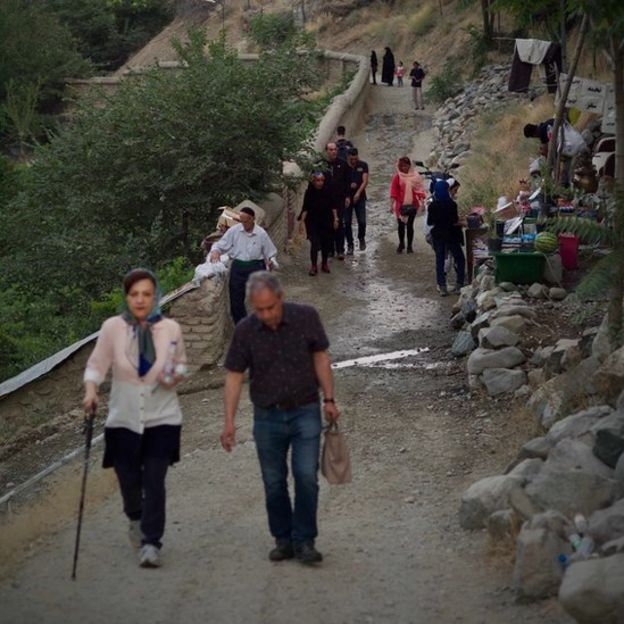 Iranians hike on a trail