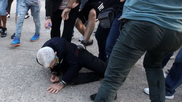 Mayor of Thessaloniki, Yiannis Boutaris, 75-years-old, is aided after being attacked on 19 May 2018.
