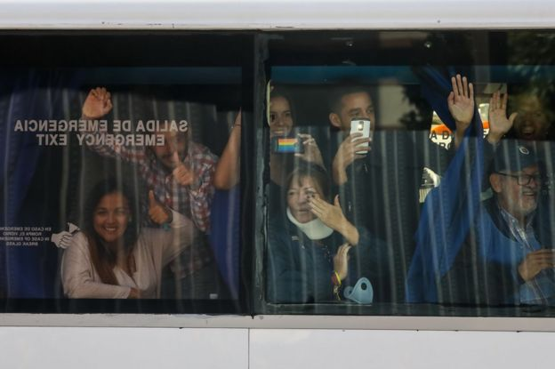 National Assembly deputies wave from a bus at the Francisco Fajardo highway, in Caracas, Venezuela, 21 February 2019