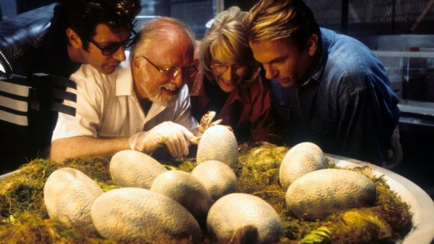 Jeff Goldblum, Richard Attenborough, Laura Dern and Sam Neill watch dinosaur eggs hatch in a scene from 'Jurassic Park'