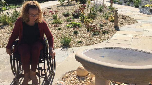 Photo shows Carrie-Ann Lightley in a garden