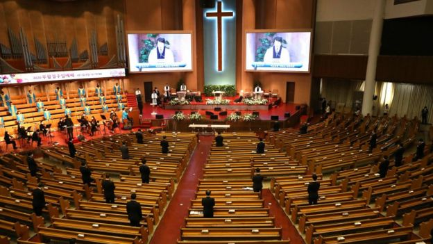Pastors wear mask as they pray during a Easter worship