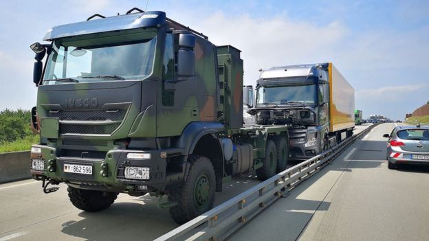 The army vehicle is shown in front of the driverless lorry