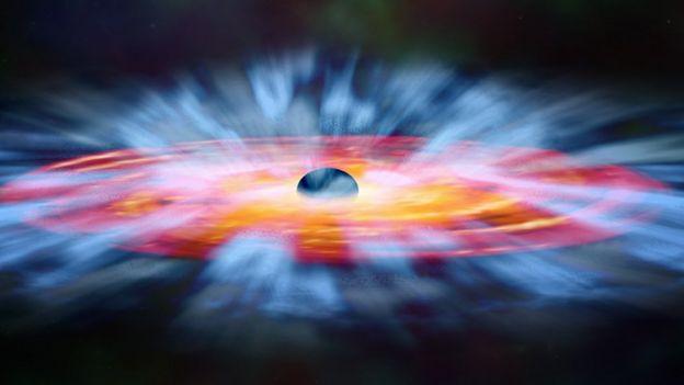 Ilustração de um buraco negro com massas de gás ao seu redor