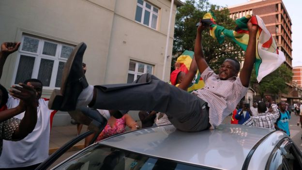 Zimbabweans celebrate after President Robert Mugabe resigns in Harare, Zimbabwe November 21, 2017