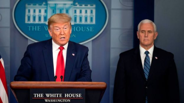 US President Donald Trump, flanked by US Vice President Mike Pence, at the White House press briefing, 3 April 2020
