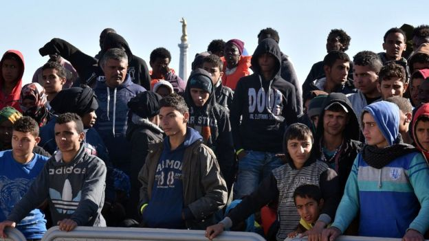 Migrants wait to disembark in Sicily (15 April)