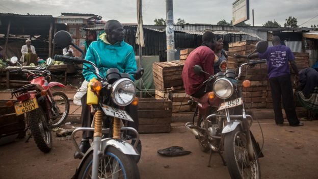 2020/03/28: Boda boda riders in Gulu are seen seated on their motorcycles after they were banned from carrying people