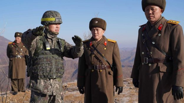 North and South Korean soldiers at the inter-Korean border