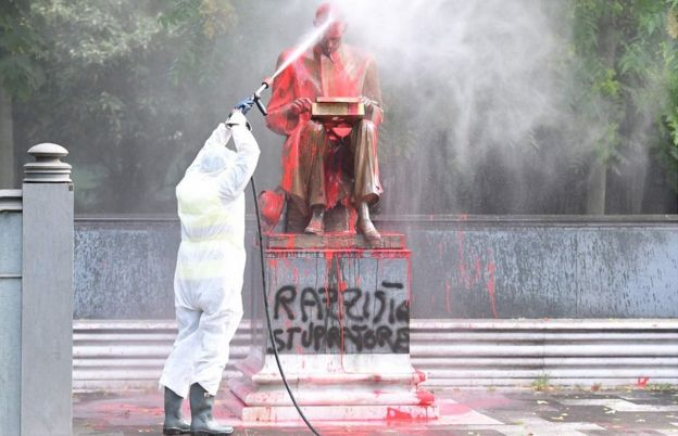 Vandalised statue of Indro Montanelli being cleaned up in Milan, 14 Jun 20