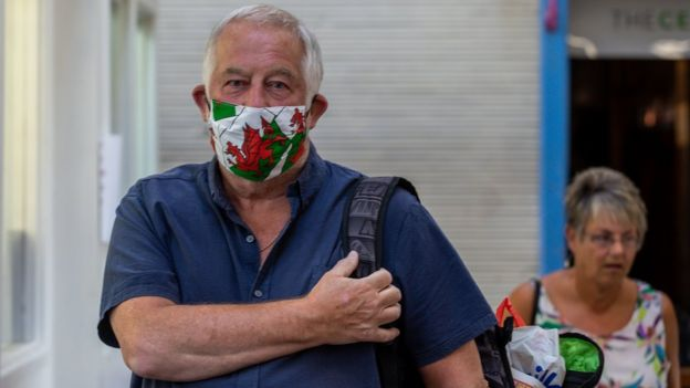 Man in Welsh flag facemask