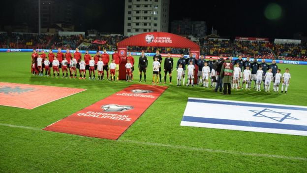Albania's and Israel's national teams are seen during the anthem singing ceremony prior to the World Cup 2018 qualifier football match between Albania and Israel at the Elbasan Arena stadium in Elbasan, Albania on November 11, 2016.