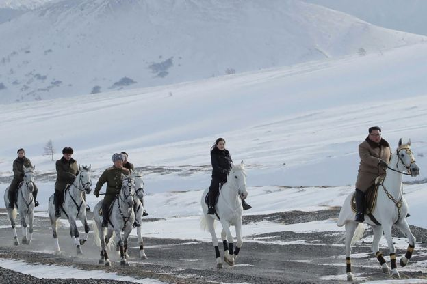 An undated picture released by North Korea's official Korean Central News Agency (KCNA) on 4 December, 2019 shows North Korean leader Kim Jong-un riding a horse as he visits battle sites at Mount Paektu, Ryanggang.