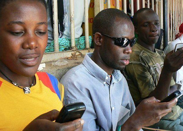 Ugandans on their mobile phones