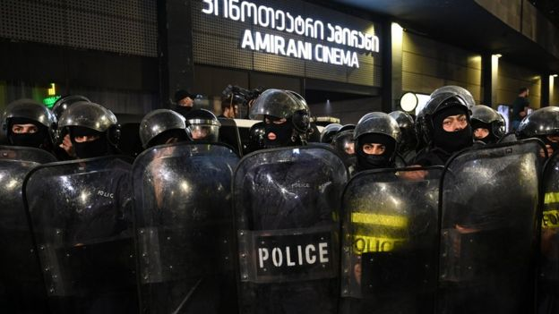 Georgian police officers stand guard in front of the Amirani cinema as far-right activists protest against the premiere screening of an Oscar-nominated Swedish-Georgian gay film in Tbilisi on November 8, 2019