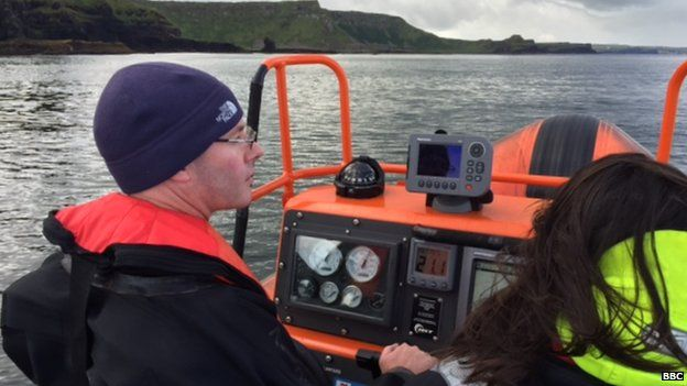 Gary Burrows driving the boat