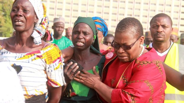 Coordinator of the 'Bring Back Our Girls' Nierian movement Oby Ezekwesili (R) helps a mother sobbing