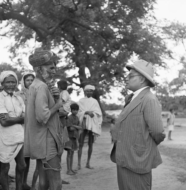 A leader of those formerly considered untouchable discusses a food shortage with a government official. Bengal Province, British India. | Location: Bengal Province, British India