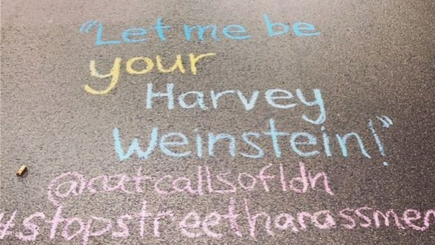 "A catcall reading ""Let me be your Harvey Weinstein"" written on the ground"