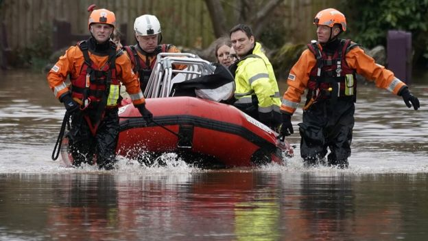Firefighters rescue staff and residents from a care home in the village of Whitchurch on the banks of the River Wye following flooding from Storm Dennis