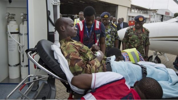 A Kenyan soldier, who Kenya Defence Forces said was injured in the attack by al-Shabab in Somalia earlier this week, is carried on a stretcher from the airplane to a waiting ambulance after being airlifted back to Nairobi for medical treatment, in Kenya Sunday, Jan. 17, 2016