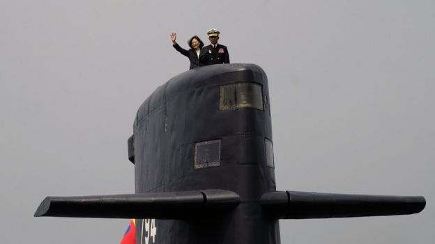 Taiwan President Tsai Ing-wen waves from a Duch-made Sea Tiger submarine at the Tsoying navy base in Kaohsiung, southern Taiwan on March 21, 2017. Taiwan formally launched an ambitious project to build its own submarines as the island faces growing military threats from China as relations deteriorate. / AFP PHOTO / SAM YEH (Photo credit should read SAM YEH/AFP/Getty Images)